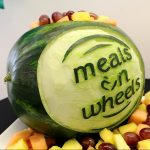 Chef Kris Almsted carved this watermelon with the Meals on Wheels logo for the Kitchen of Opportunities Grand Opening