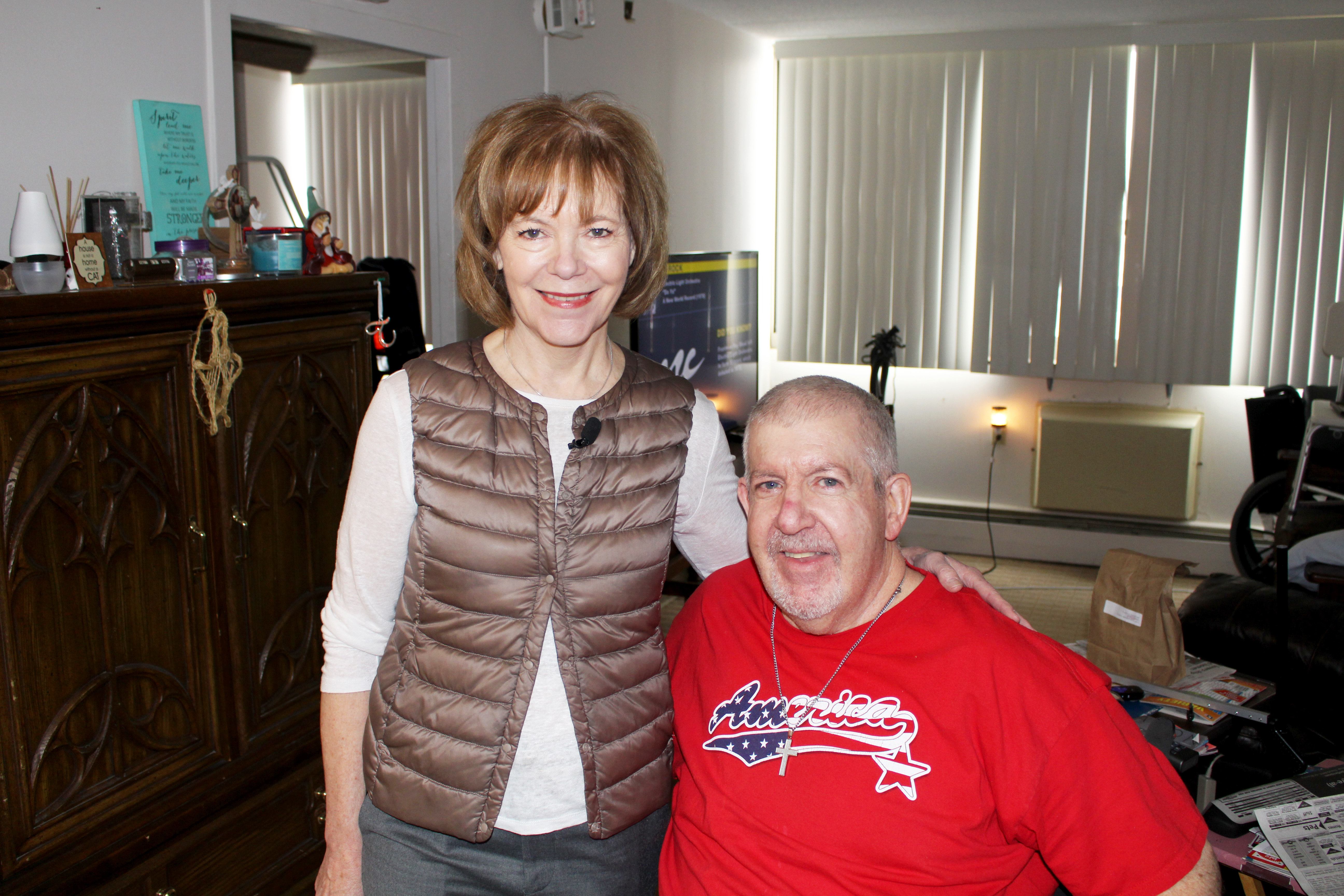 Meal recipient Tom Barger pictured with Sen. Tina Smith