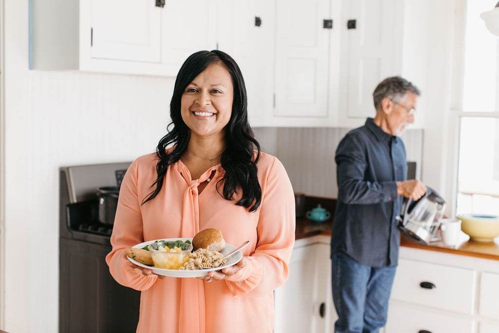 Woman with Meals on Wheels meal for her father