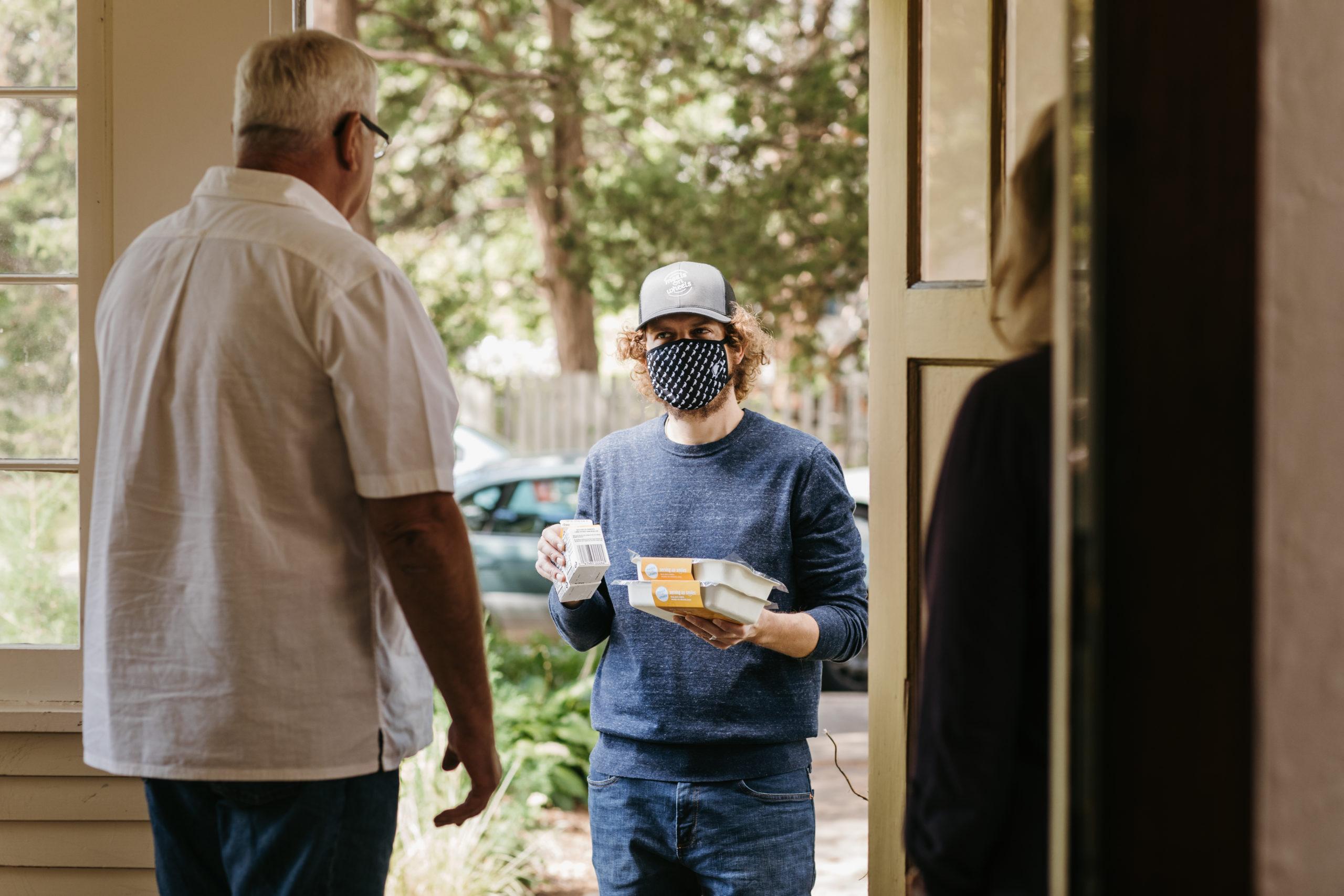 Volunteer delivering meals